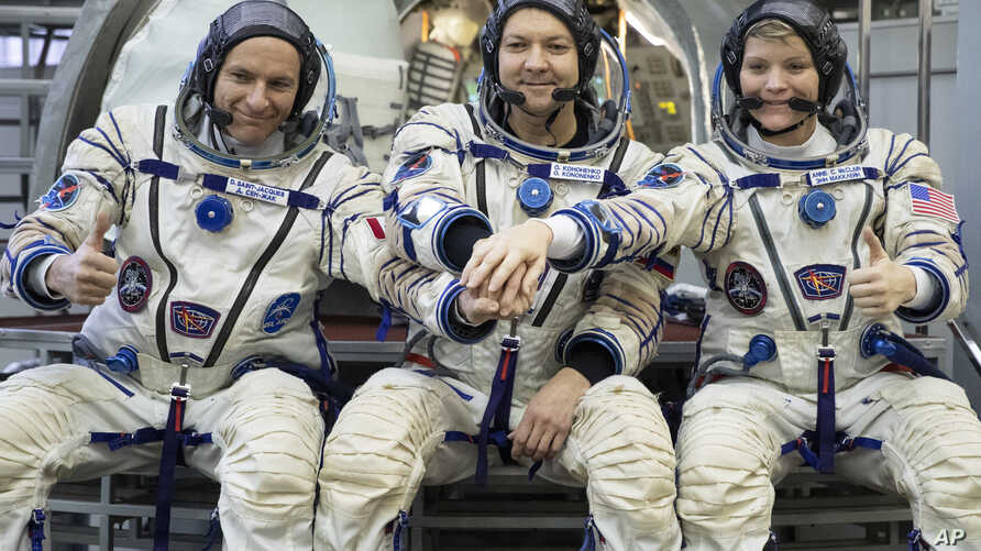 From left: CSA astronaut David Saint Jacques, Russian cosmonaut Оleg Kononenko‎ and U.S. astronaut Anne McClain pose in a mock-up of a Soyuz space craft at Russian Space Training Center in Star City, Russia, Nov. 14, 2018.