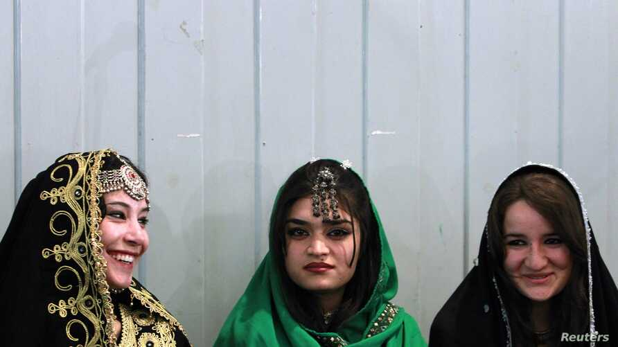 Young Afghan women attend teachers' graduation ceremony, Kabul, March 30, 2011.