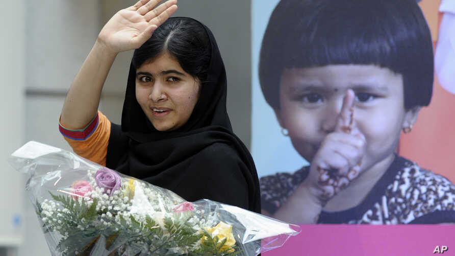 Malala Yousafzai, the 16-year-old girl from Pakistan who was shot in the head by the Taliban last October for advocating education for girls, waves as she leaves the stage after speaking about her fight for girls' education on the International Day o