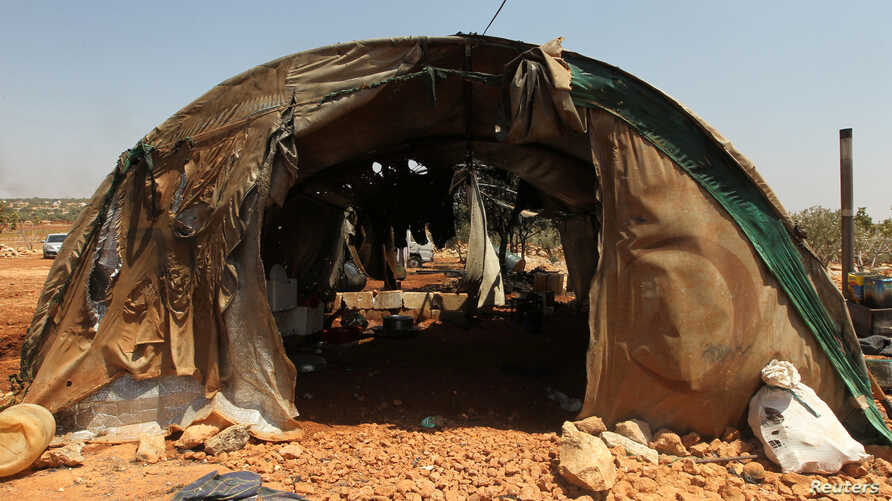 A damaged tent for displaced people is pictured after airstrikes on the outskirts of the rebel-held town of Atareb in Aleppo province, Syria, Aug. 4, 2016.