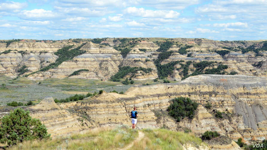 Mikah Meyer takes in the view at Theodore Roosevelt National Park in North Dakota