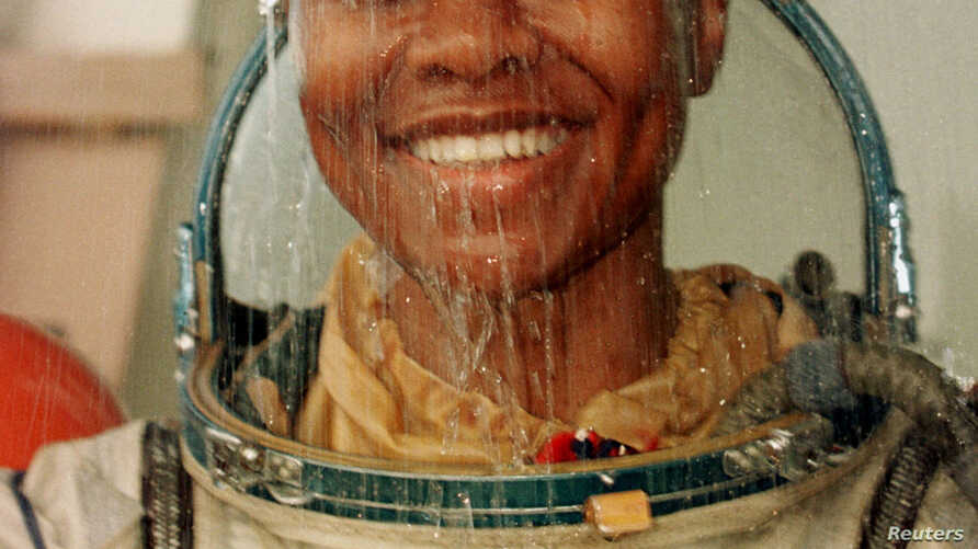 U.S. astronaut Yvonne Cagle smiles as she takes a shower after a training in the Black Sea near the village of Kudepsta, Russia, June 27, 1999. Cagle, who is also a medical doctor, recently talked about her training at Town Hall Los Angeles, where sh