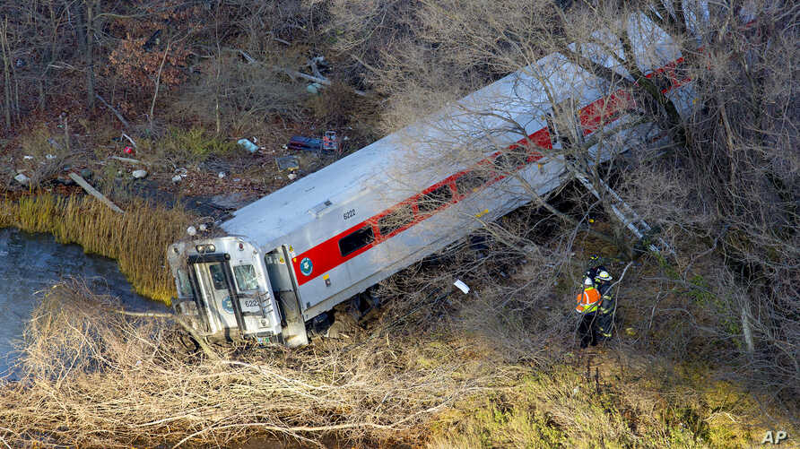 "First responders view the derailment of a Metro North passenger train in the Bronx borough of New York Dec. 1, 2013. The Fire Department of New York says there are ""multiple injuries"" in the  train derailment, and 130 firefighters are on the scene. M..."