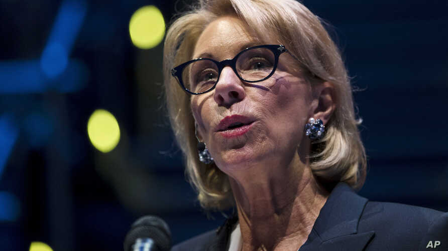 FILE - Education Secretary Betsy DeVos speaks during a student town hall at National Constitution Center in Philadelphia, Monday, Sept. 17, 2018.