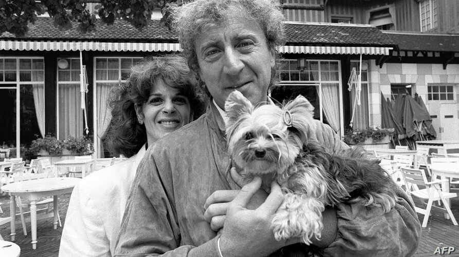 FILE - Actor and director Gene Wilder poses with his wife Gilda Radner, during the 10th American Film Festival of Deauville, France, Sept. 7, 1984.