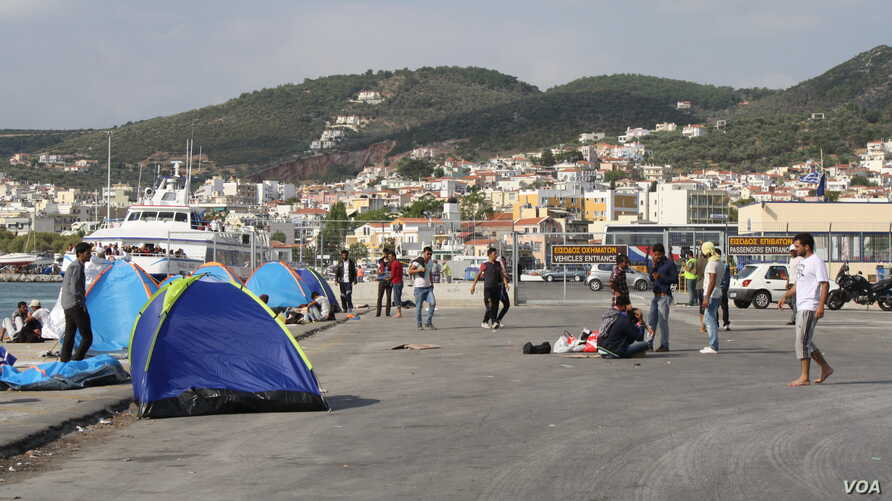 At the port in Lesvos, Greece, many refugees from Afghanistan, Iraq and Syria who cannot afford the 48 euros for a boat to their next destination wait in tents, many hoping to find another way. (Credit: Heather Murdock/VOA)