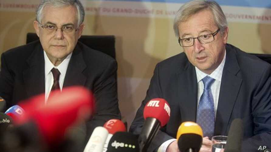 Luxembourg's Prime Minister and head of the eurogroup Jean-Claude Juncker, right, and Greek Prime Minister Lucas Papademos participate in a media conference in Luxembourg, November 22, 2011.