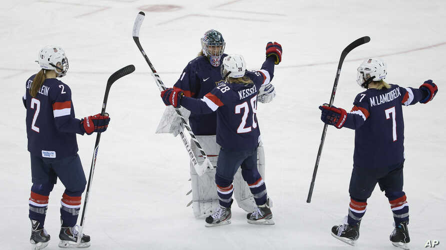 USA Goalkeeper Jessie Vetter and Amanda Kessel meet near mid ice with Lee Stecklein and Monique Lamoureux after defeating Sweden 6-1 during a 2014 Winter Olympics women's semifinal ice hockey game at Shayba Arena, Monday, Feb. 17, 2014.