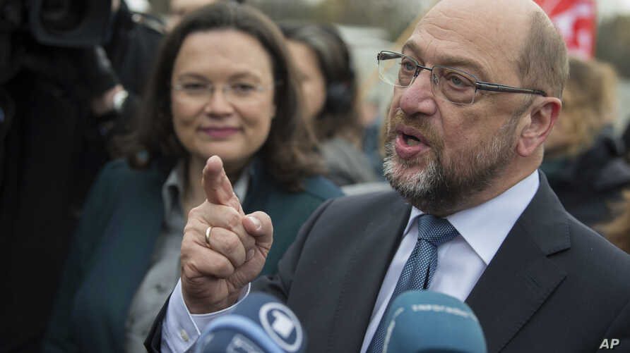 FILE - Chairman of Germany's Social Democratic Party Martin Schulz, right,  and the SPD faction leader in the Bundestag, Andrea Nahles, speak to reporters in Berlin.