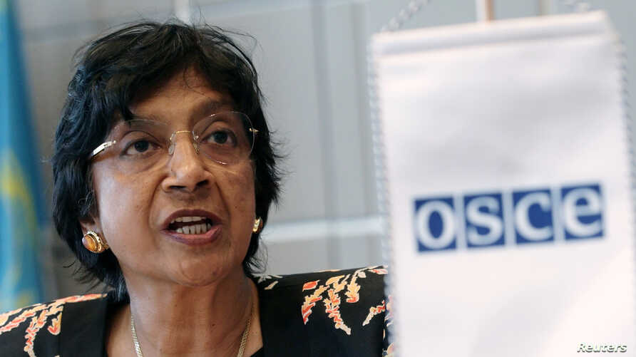 U.N. High Commissioner for Human Rights Navi Pillay addresses the OSCE permament council in Vienna July 3, 2014. REUTERS/Heinz-Peter Bader  (AUSTRIA - Tags: POLITICS) - RTR3WXBN
