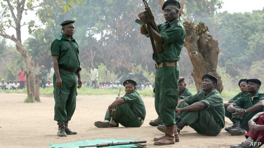 """Fighters of the former Mozambican rebel movement """"Renamo"""" receiving military training, Nov. 8, 2012"""