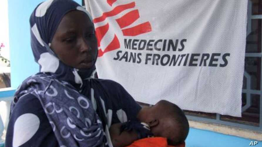A Somali mother brings her child for vaccination for measles at a Medecines Sans Frontieres, Holland clinic hospital in Mogadishu, Somalia (File Photo).