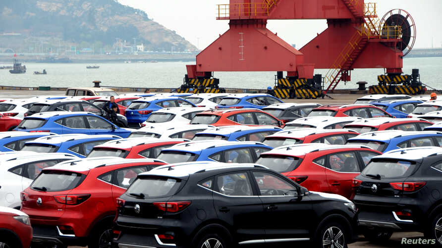 Sports utility vehicles (SUVs) waiting to be exported are seen at a port in Lianyungang, Jiangsu province, China, Apr. 5, 2018.