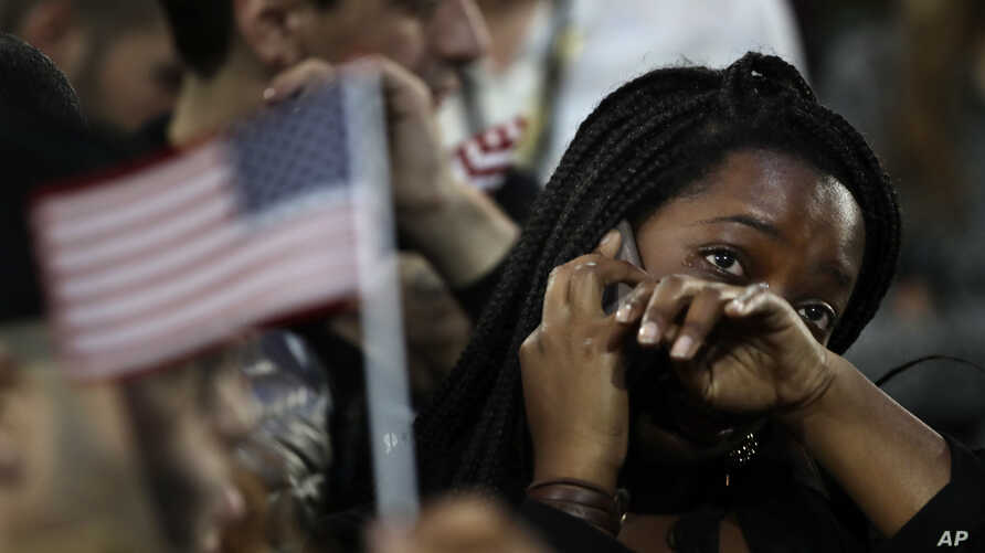 A woman weeps as election results are reported, Nov. 8, 2016, during Democratic presidential nominee Hillary Clinton's election night rally in the Jacob Javits Center glass enclosed lobby in New York.