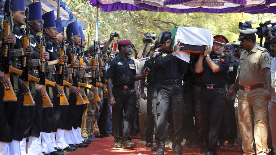 The body of India's National Security Guard commando, Niranjan Kumar, is carried by Indian soldiers as they pay their last respects in Bangalore, India, Jan. 4, 2016.
