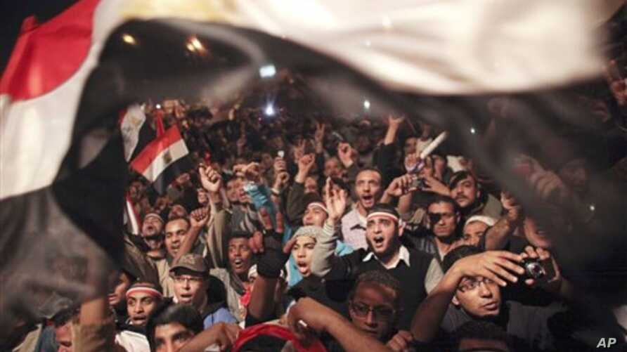 Egyptians celebrate the news of the resignation of President Hosni Mubarak, who handed control of the country to the military, Cairo, Egypt, February 11, 2011