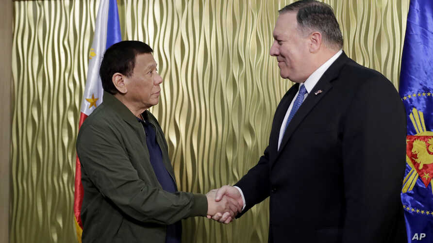 Philippine President Rodrigo Duterte, left, greets U.S. State Secretary Mike Pompeo upon arrival at Villamor Air Base in suburban Pasay city southeast of Manila, Philippines, Thursday, Feb. 28, 2019.