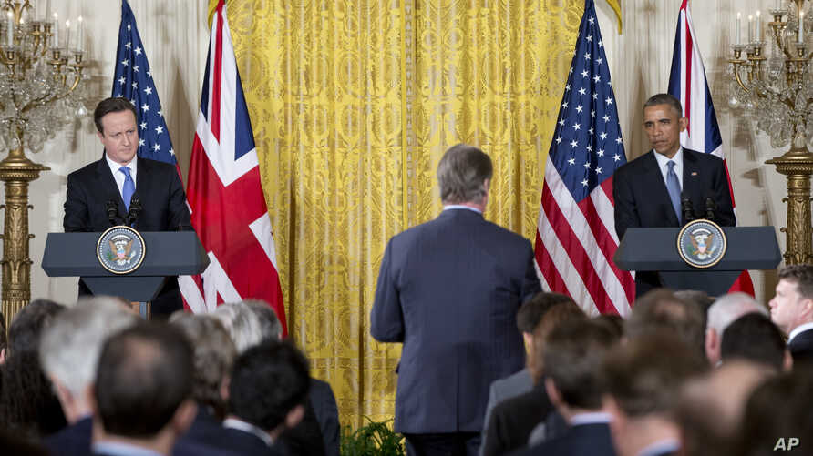 President Barack Obama and British Prime Minister David Cameron hold a joint news conference in the East Room of the White House in Washington, Friday, Jan. 16, 2015. The president and prime minister agreed Friday to a joint effort to fight domestic ...