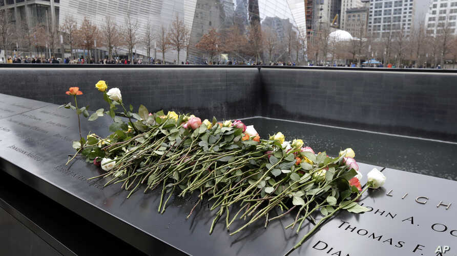 Roses are placed on the 9/11 Memorial during 25th anniversary ceremony to commemorate the six victims of the 1993 World Trade Center bombing, in New York, Feb. 26, 2018.