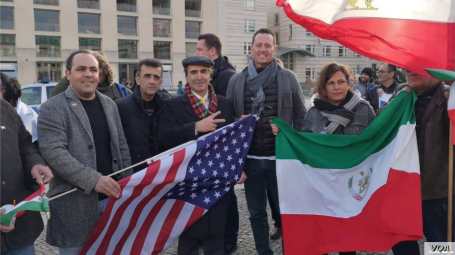 U.S. Ambassador to Germany Richard Grenell joins Iranian activists protesting the 40th anniversary of Iran's Islamic Revolution at a rally near the Brandenburg Gate in Berlin, Feb. 10, 2019.
