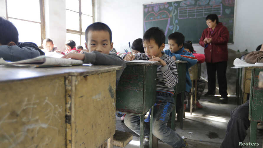 FILE - Students attend class at Pengying School on the outskirts of Beijing.