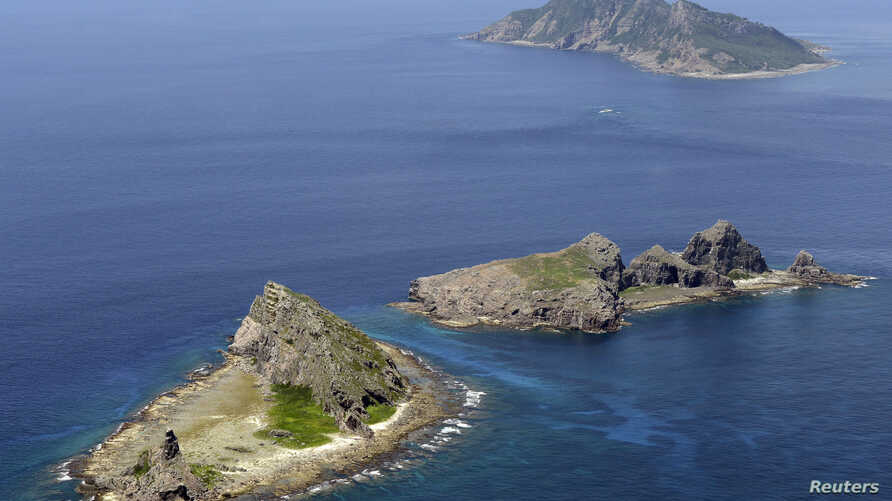 FILE - A group of disputed islands, Uotsuri island (top), Minamikojima (bottom) and Kitakojima, known as Senkaku in Japan and Diaoyu in China is seen in the East China Sea, in this photo taken by Kyodo September 2012.