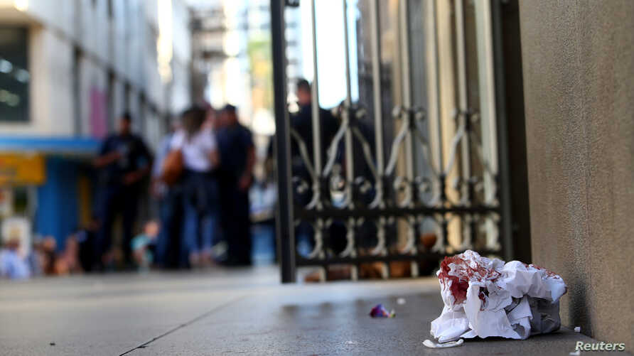 A cloth with blood is seen in front of of the Catholic cathedral where a gunman opened fire to the faithful, in Campinas, Brazil, Dec. 11, 2018