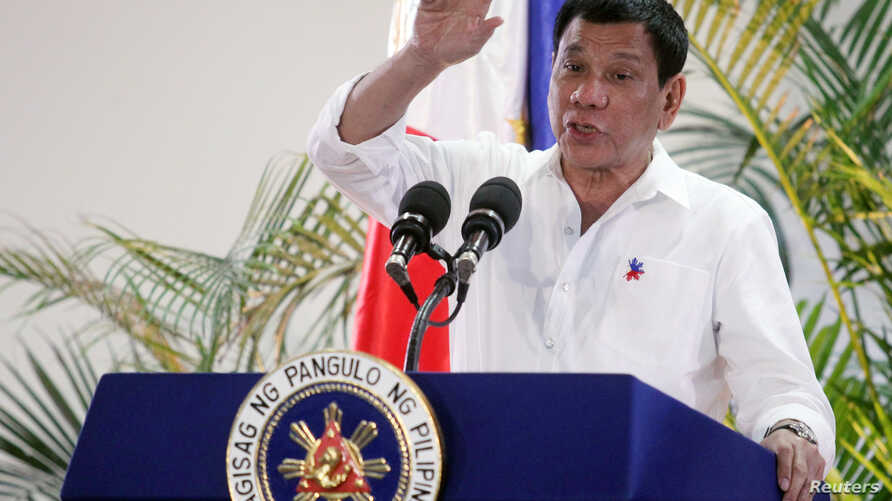 Philippine President Rodrigo Duterte gestures while answering questions during a news conference upon his arrival from a state visit in Japan at the Davao International Airport in Davao city, Philippines October 27, 2016.