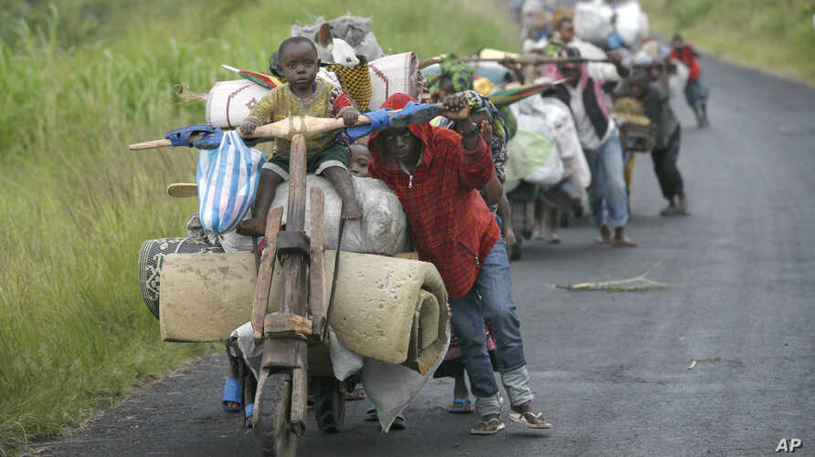 Congolese flee the eastern Congolese town of Sake , 27km west of Goma, Friday Nov. 23 2012.