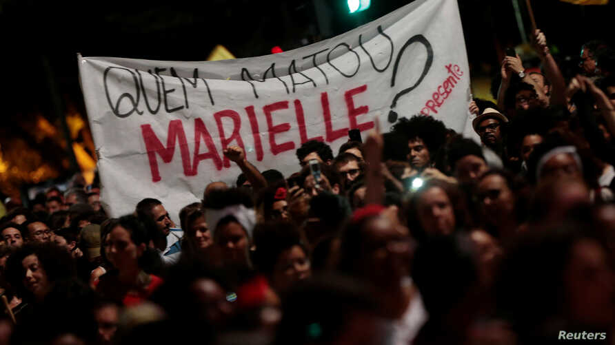People take part in a rally against the murder of Brazilian councilwoman Marielle Franco, in Sao Paulo, Brazil, March 15, 2018.