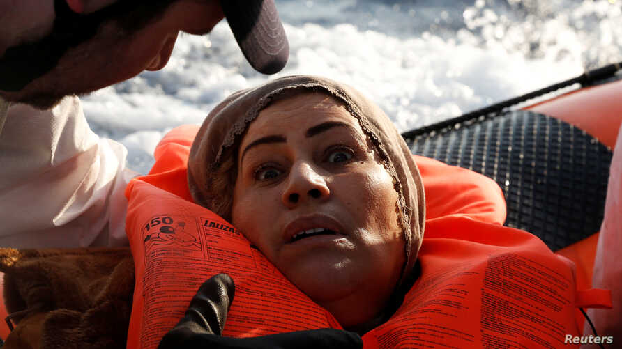 A migrant reacts after being rescued by the Malta-based NGO Migrant Offshore Aid Station (MOAS) after they were spotted adrift on board a wooden boat in the central Mediterranean north of Sabratha on the Libyan coast, April 5, 2017.