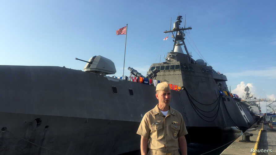 FILE - Chief of U.S. Naval Operations Admiral John Richardson poses after speaking to reporters on the pier of the USS Coronado, a littoral combat ship, at the Changi Naval Base in Singapore, May 16, 2017.