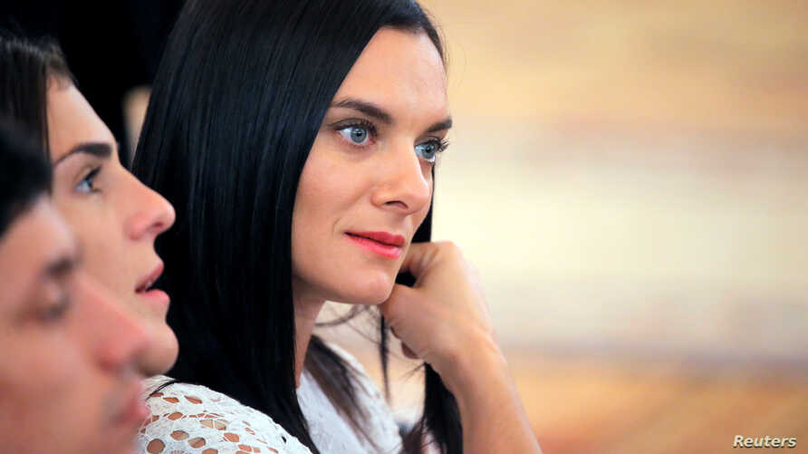 FILE - Russian pole vaulter Yelena Isinbayeva attends an awards ceremony for Russian Olympic medalists returning home from the 2016 Rio Olympics at the Kremlin in Moscow, Aug. 25, 2016. Isinbayeva has been named head of the country's scandalized anti