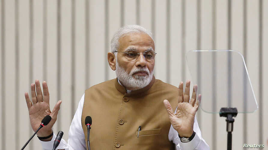 FILE - India's Prime Minister Narendra Modi gestures as he addresses the gathering during the 'Global Mobility Summit' in New Delhi, India, Sept. 7, 2018.