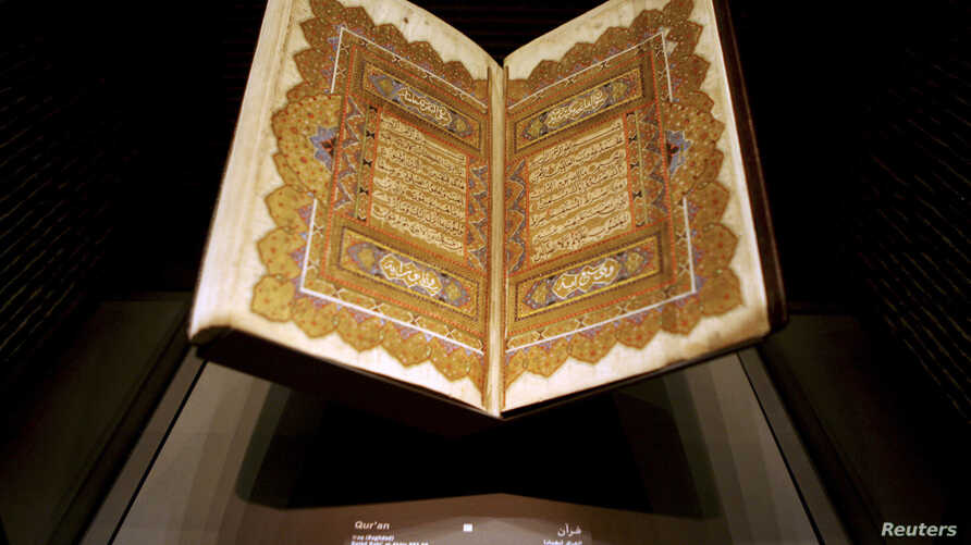 Pages from a copy of the Koran dating back to 1284 are displayed at an exhibition in Doha, Qatar, Dec. 2, 2008.