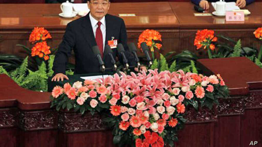 Chinese Premier Wen Jiabao delivers the government report at the opening session of the annual National People's Congress in the Great Hall of the People in Beijing, March 5, 2011