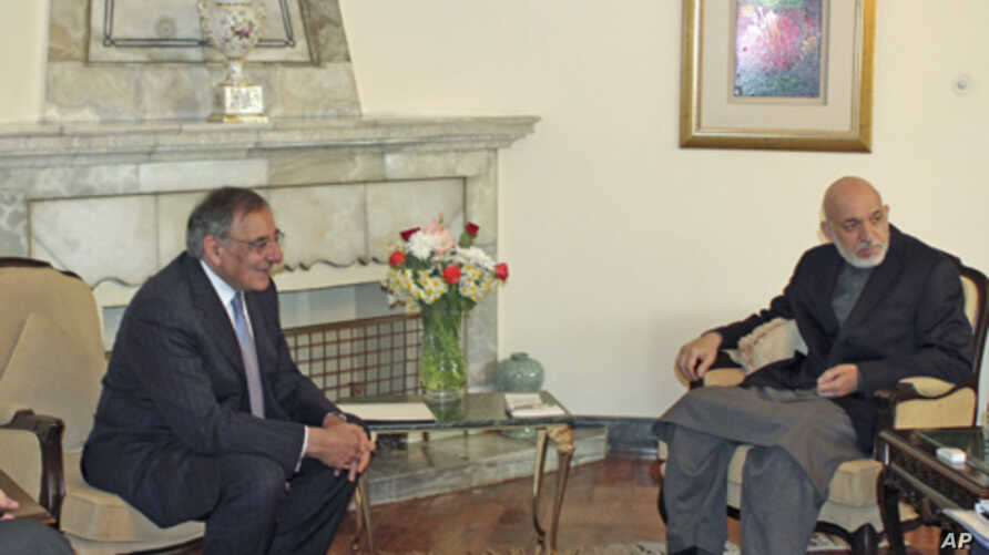 Afghanistan's President Hamid Karzai (R) meets with U.S. Secretary of Defense Leon Panetta in Kabul, March 15, 2012.