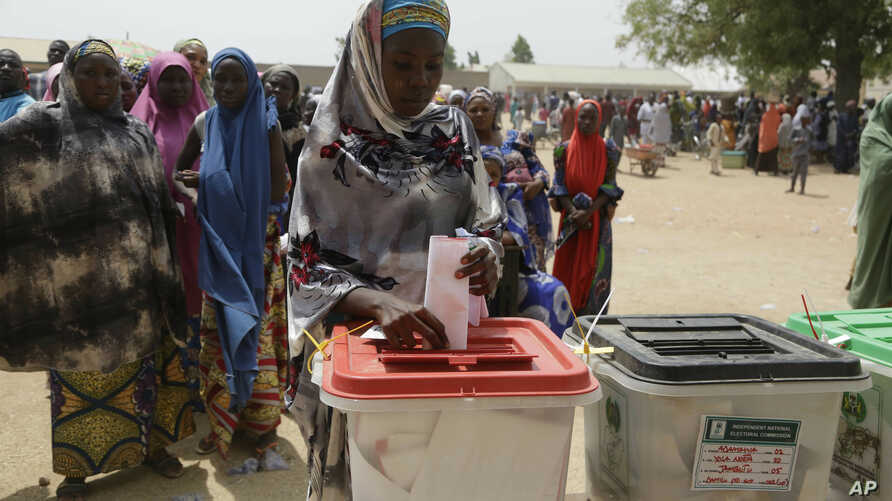 A woman cast her votes during the presidential and National Assembly elections in Damilu Yola, Nigeria, Feb. 23, 2019.