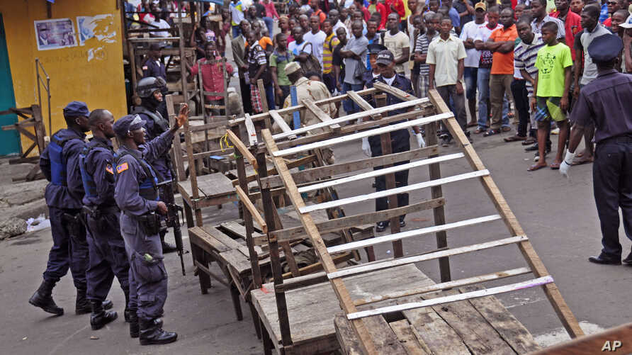 Liberia security forces blockade an area around the West Point Ebola center as the government clamps down on the movement of people to prevent the spread of the Ebola virus in the city of Monrovia, Liberia, Wednesday, Aug. 20, 2014. Security forces d...