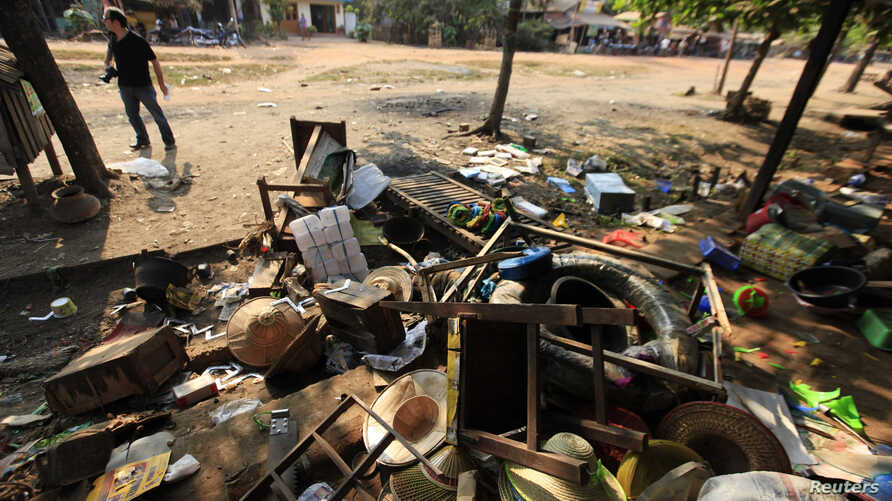 Destroyed furniture and belongings are seen in a market in Sit Kwin, Burma, Mar. 29, 2013.