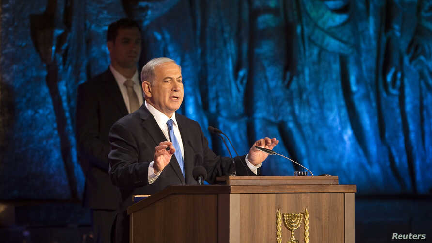 Israel's Prime Minister Benjamin Netanyahu speaks during the opening ceremony of Holocaust Memorial Day at the Yad Vashem Holocaust Memorial in Jerusalem April 27, 2014.