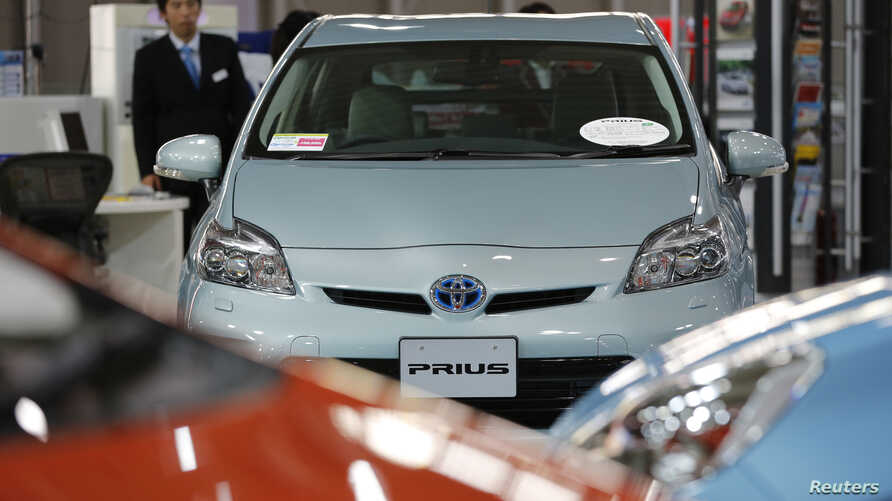 A Toyota Motor Corp Prius vehicle and other vehicles are displayed at the company's showroom in Tokyo, November 14, 2012.