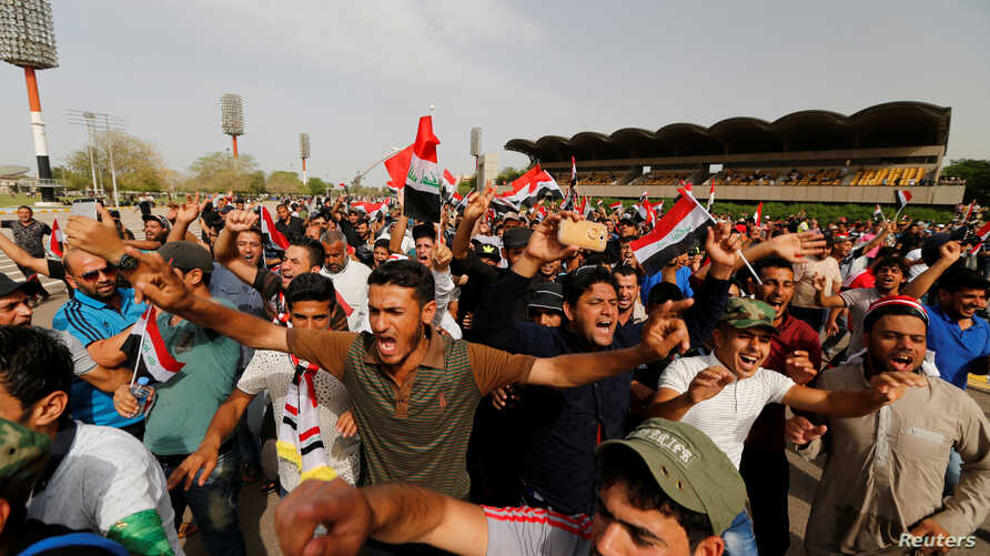 Followers of Iraq's Shi'ite cleric Moqtada al-Sadr shout slogans at Grand Festivities Square within the Green (International) Zone in Baghdad, Iraq, May 1, 2016.