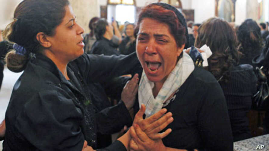 A Coptic Christian woman grieves during the funeral for victims of  clashes between Muslims and Christians in Cairo, May 8, 2011