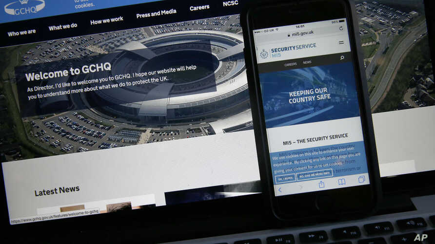 FILE - This photo-illustration shows a web pages for GCHQ, the British governments communications and electronic surveillance headquarters, and The Security Service (MI5), the governments internal security service, on a computer and smartphone in Lon