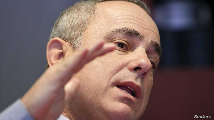 Yuval Steinitz speaks during an interview in New York, Jan. 28, 2013 file photo.