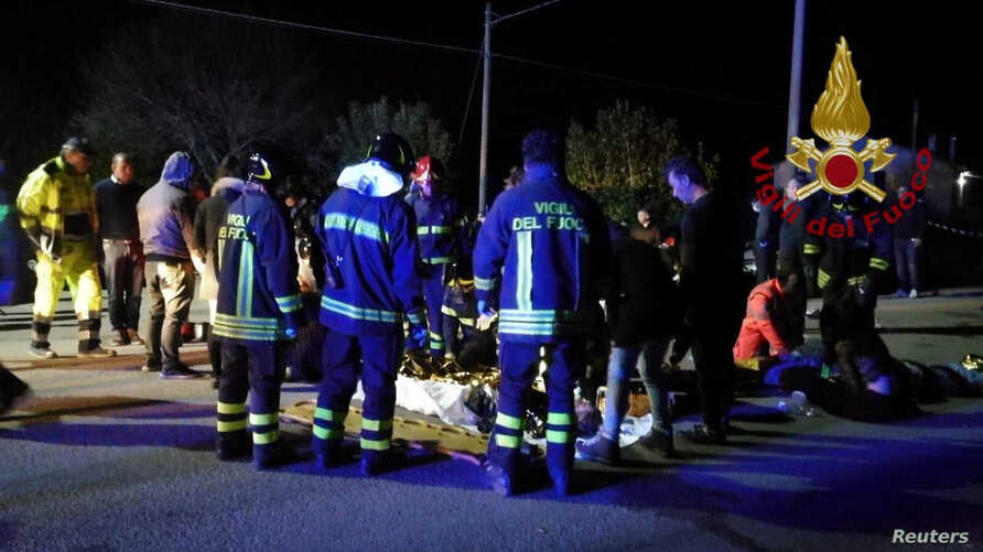 Emergency personnel attend to victims of a stampede at a nightclub in Corinaldo, near Ancona, Italy, in this undated handout picture obtained by Reuters, Dec. 8, 2018.