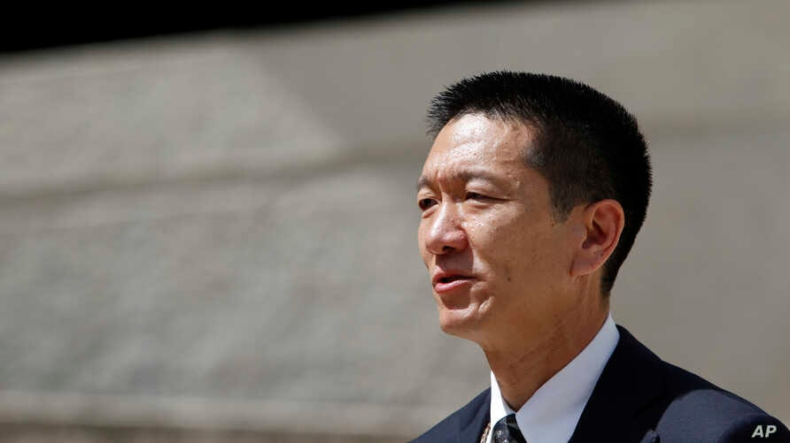 Hawaii Attorney General Douglas Chin speaks at a press conference outside the federal courthouse, March 15, 2107, in Honolulu. Chin sent at letter, signed by the attorneys general of 17 other states and the District of Columbia, seeking congressional