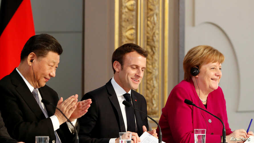 French President Emmanuel Macron, Chinese President Xi Jinping and German Chancellor Angela Merkel hold a news conference at the Elysee presidential palace in Paris, March 26, 2019.