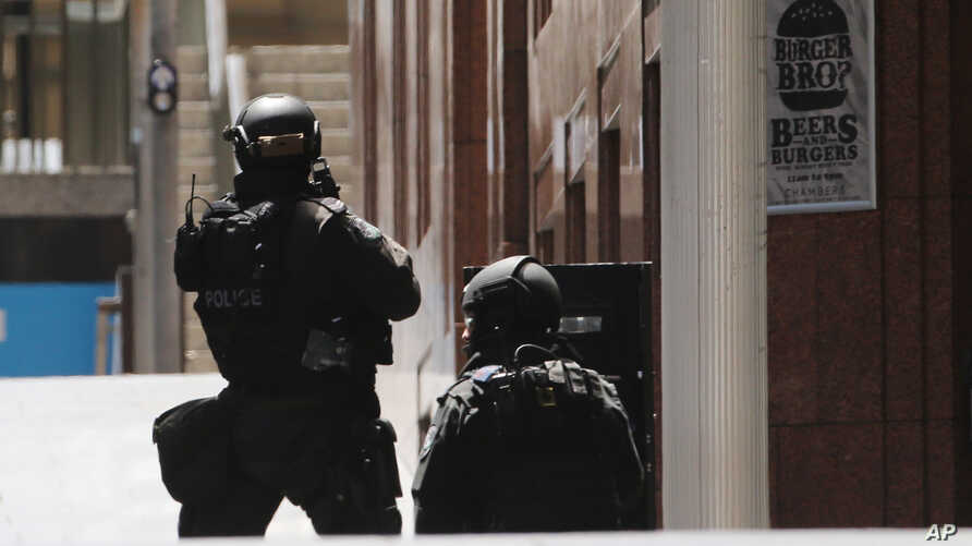 Police anti-terror forces are seen dispatched in Martin Place in the central business district of Sydney, Australia, Dec. 15, 2014.